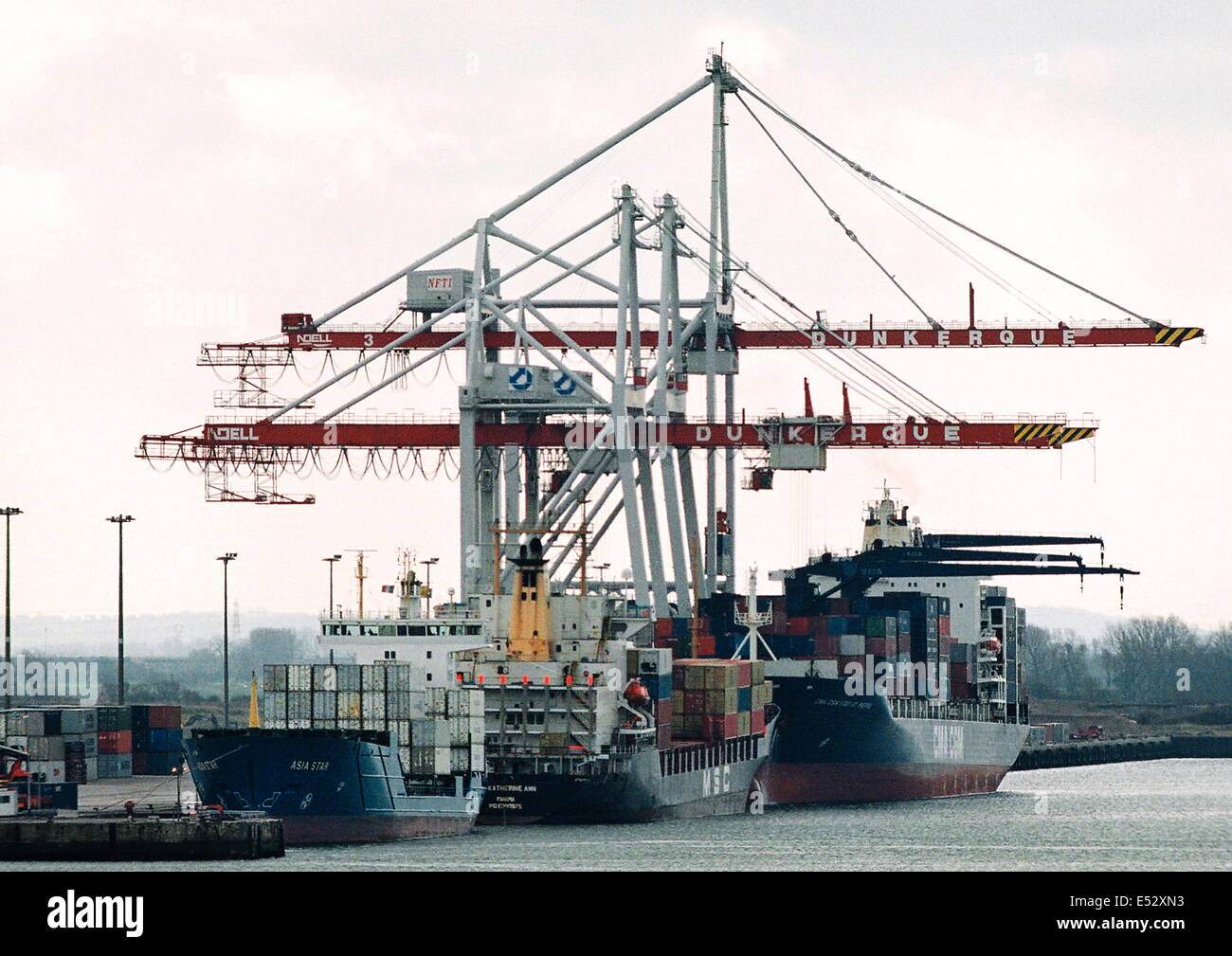 AJAXNETPHOTO. DUNKERQUE, FRANCE-Container ships and cranes at the docks. PHOTO:JONATHAN EASTLAND/AJAX Stock Photo