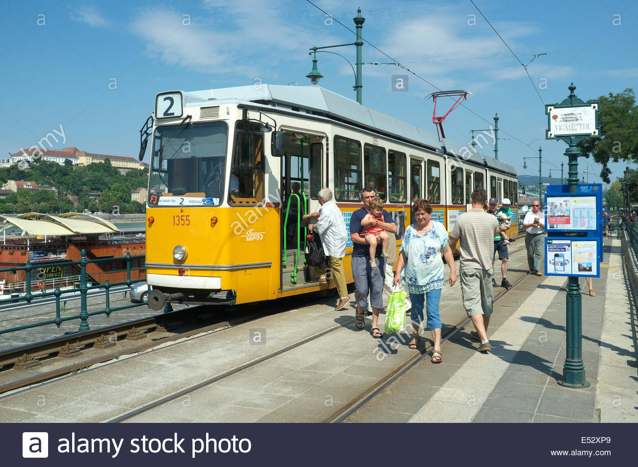 Passengers alight and embark at the Vigadó tér Tram Stop, in Pest, Budapest, Hungary. Stock Photo