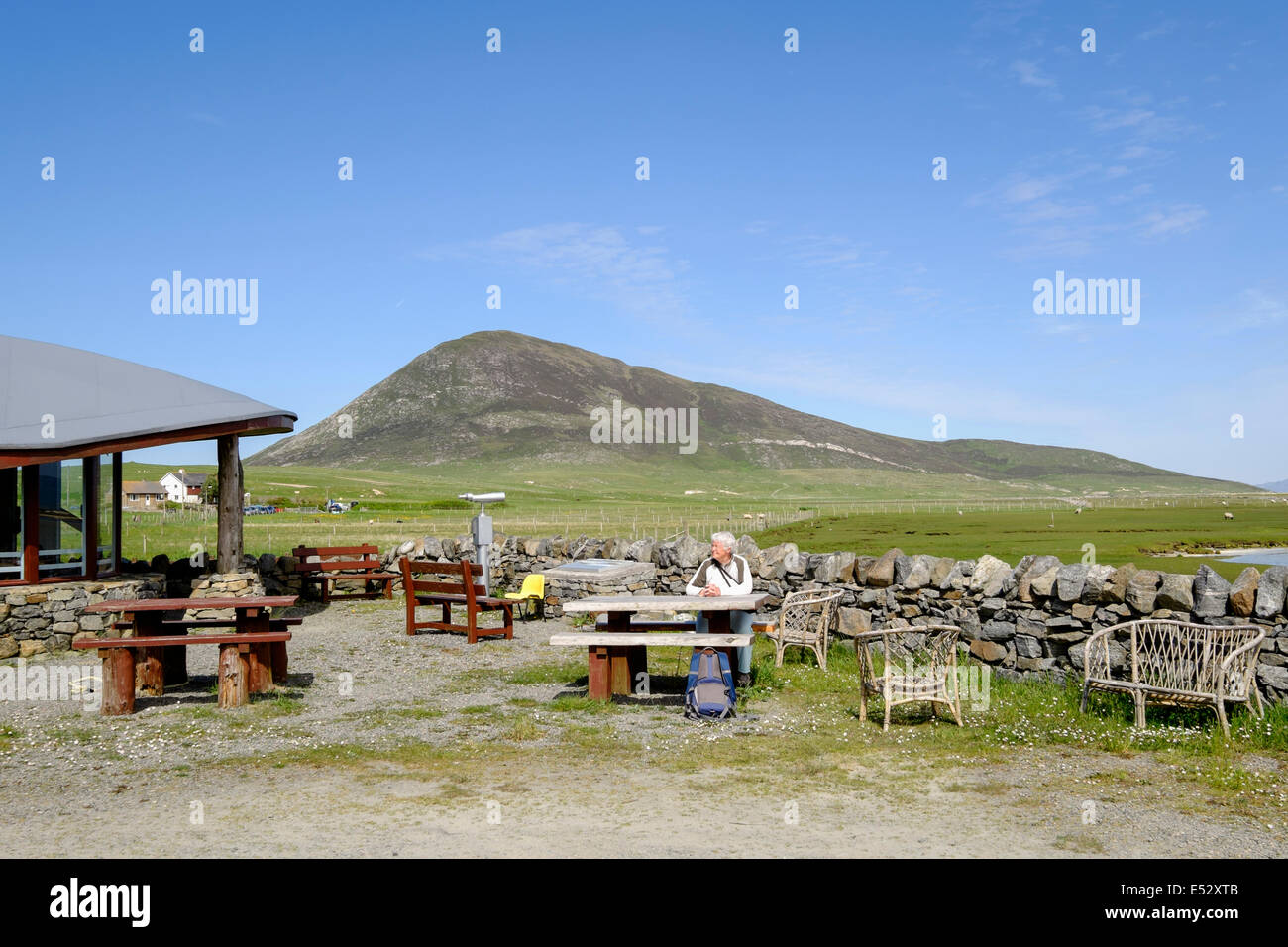 Customer sitting outside the The Temple cafe in Northton Isle of Harris Outer Hebrides Western Isles Scotland UK - Stock Image
