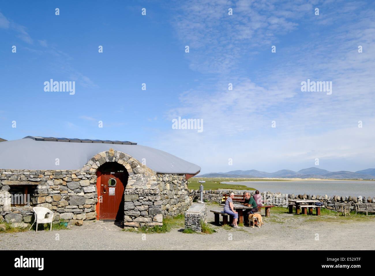 Customers outside The Temple cafe with scenic sea view. Northton Isle of Harris Outer Hebrides Western Isles Scotland Stock Photo