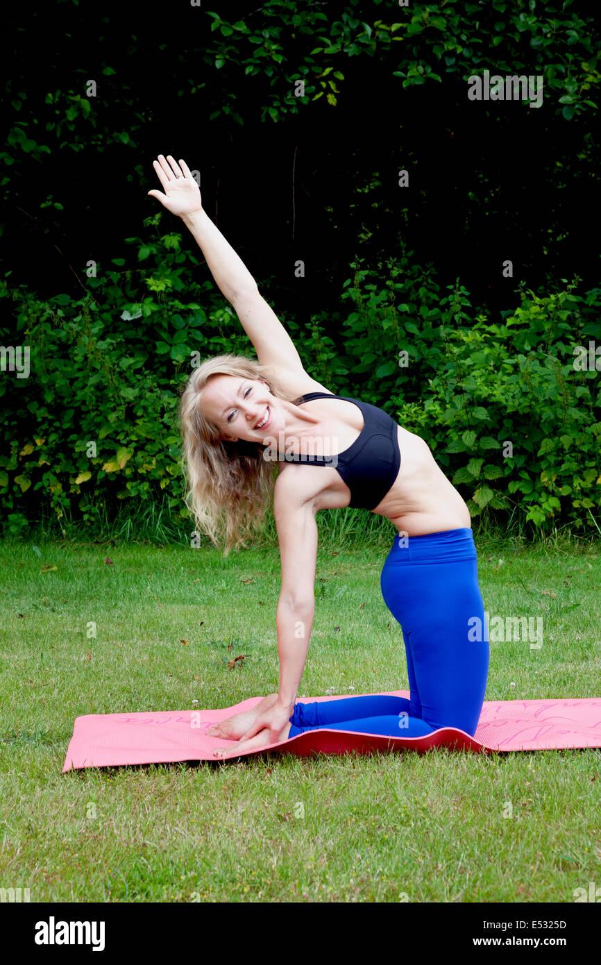 WASHINGTON - Yoga instructor Carly Hayden warming up.  (MR# H13) - Stock Image