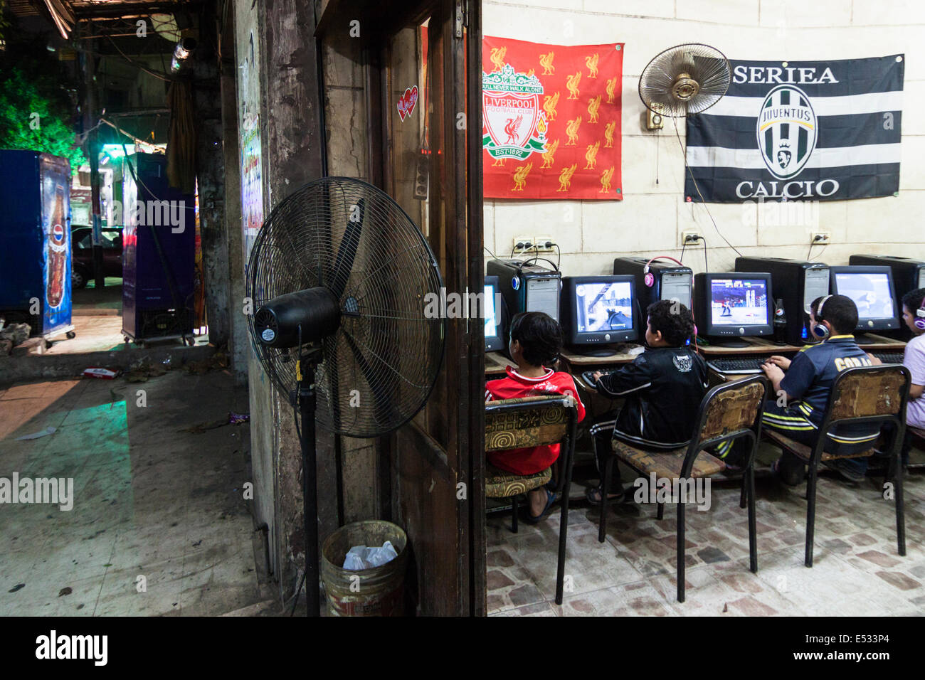 Children playing video games at a web cafe in Old Cairo, Egypt - Stock Image