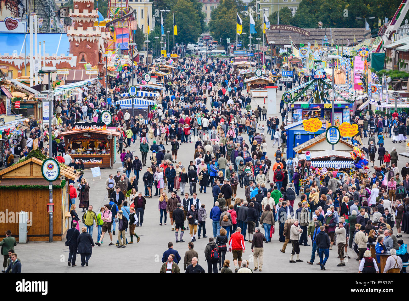 Visitors explore the Theresienwiese Oktoberfest fair grounds. - Stock Image