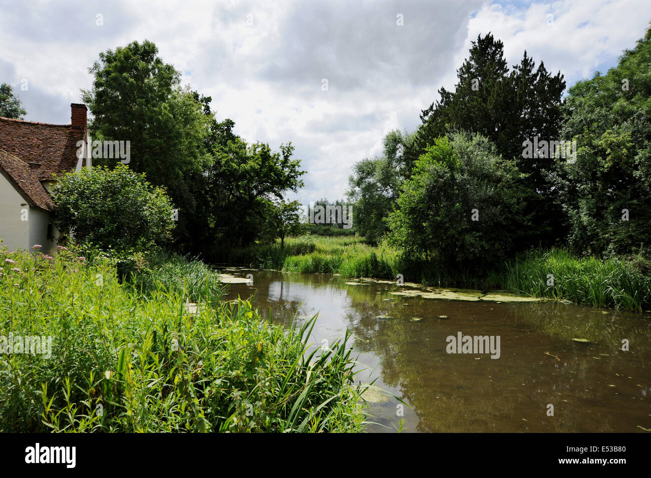 This is the famous view which formed Constable's most famous painting The Hay Wain at Flatford Mill Suffolk UK Stock Photo