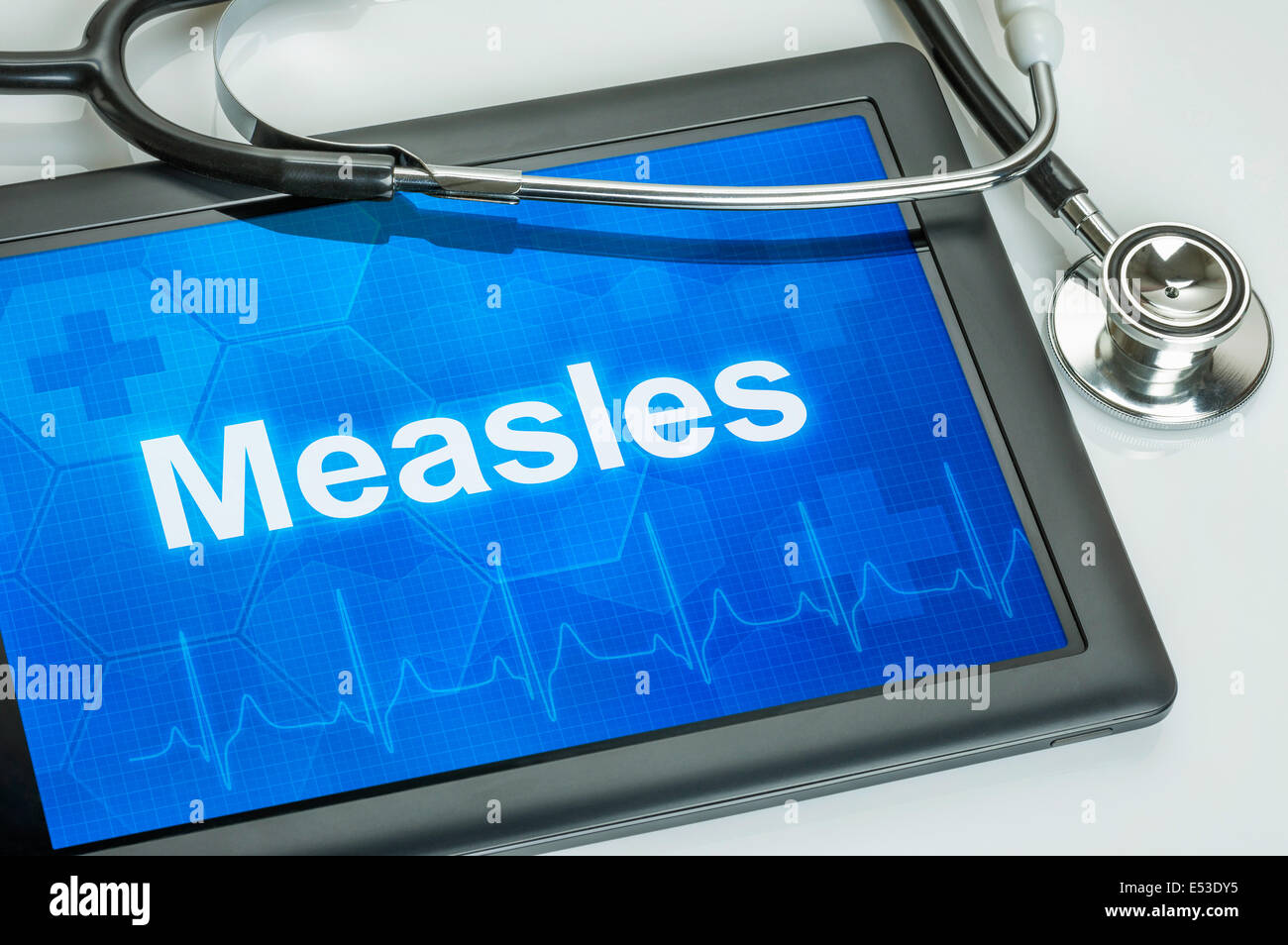 Tablet with the diagnosis Measles on the display - Stock Image