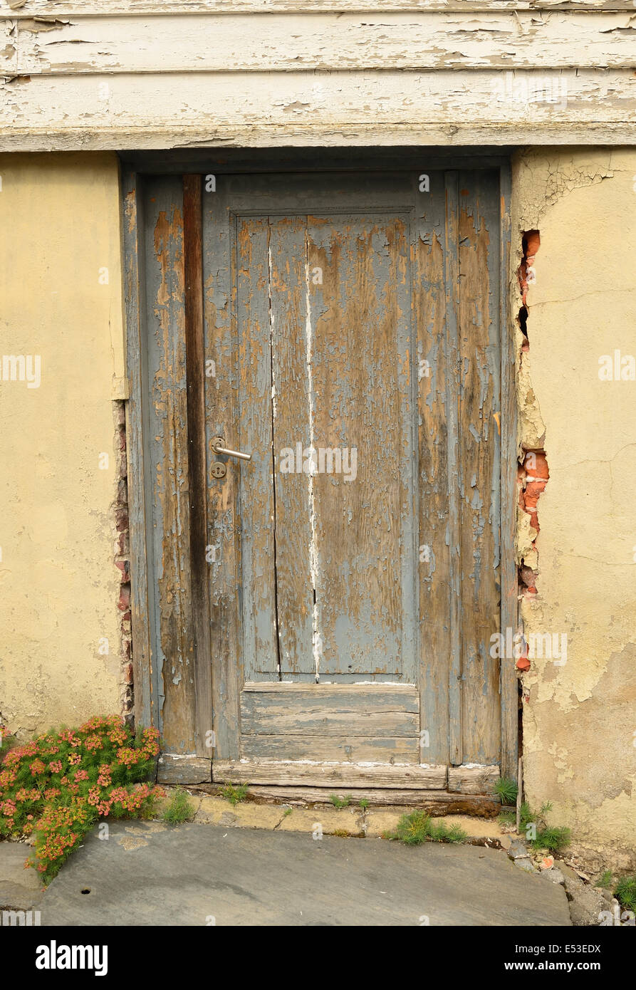 Old door in need of repair. - Stock Image