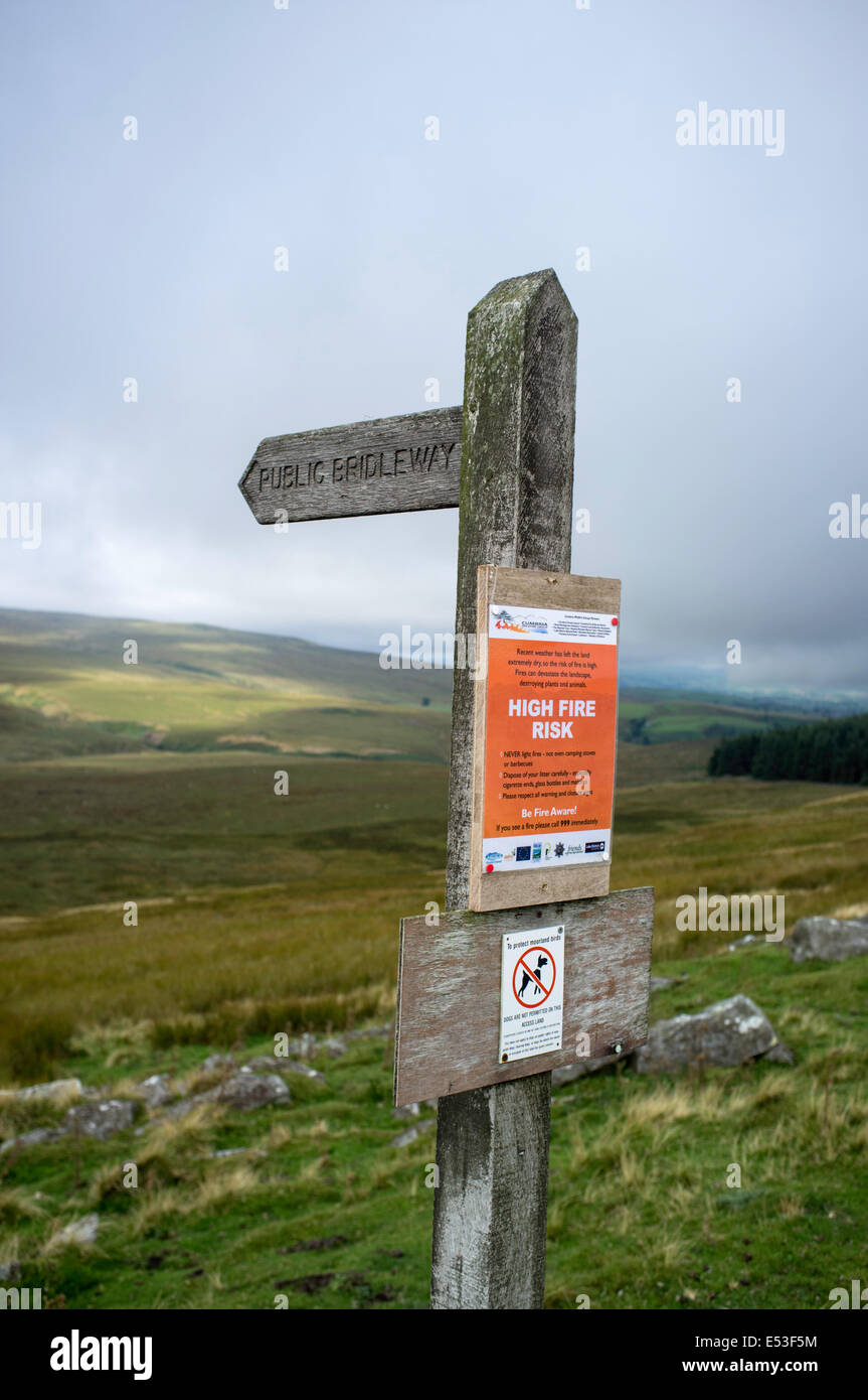 Warning sign of a high fire risk to upland countryside on a Bridleway sign, England, UK - Stock Image
