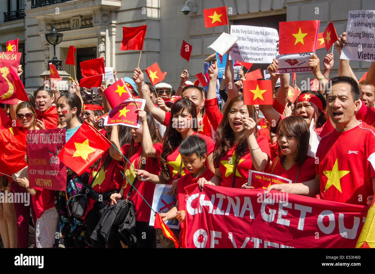 LONDON, ENGLAND  MAY 18, 2014:  Vietnamese protesters demonstrating against China moving an oil rig into disputed - Stock Image