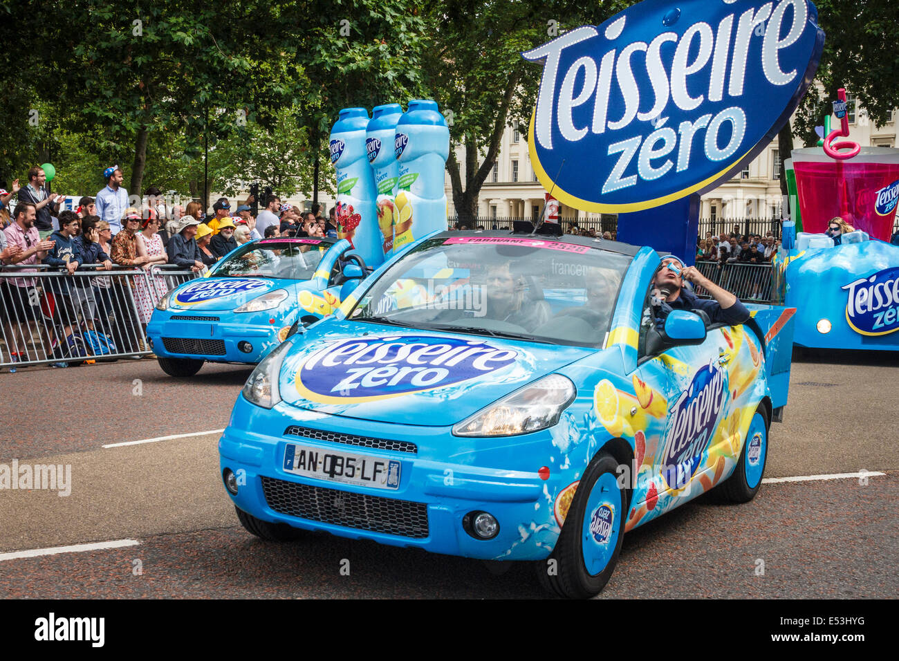 Sponsors' vehicles precede the arrival of the riders in the Tour De France 2014 third stage in London, UK - Stock Image