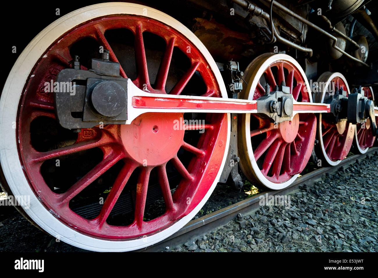 Old steam engine locomotive propulsion mechanism wheels machinery power strength strong powerful steel Stock Photo