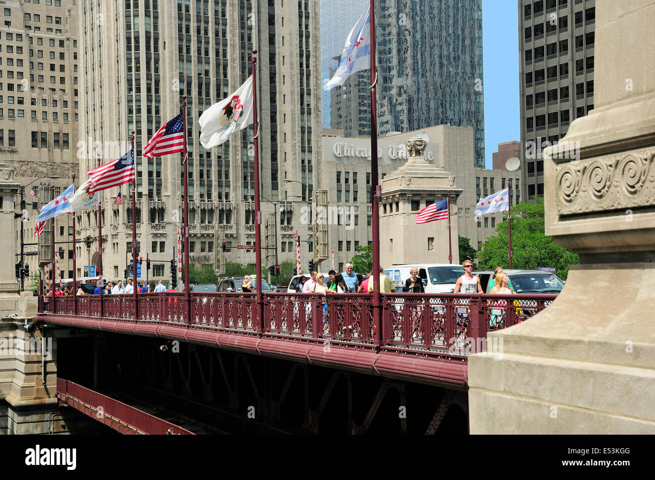 People crossing the DuSable bridge over the Chicago River. - Stock Image