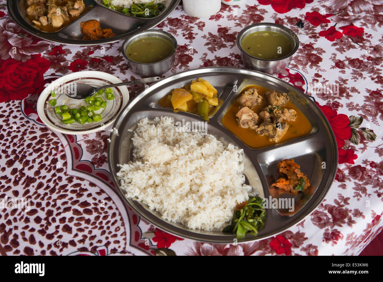 Nepal, Tikedungha, typical Nepali, food, meal of dal bhat on thali plate, rice and lentils, with vegetables - Stock Image