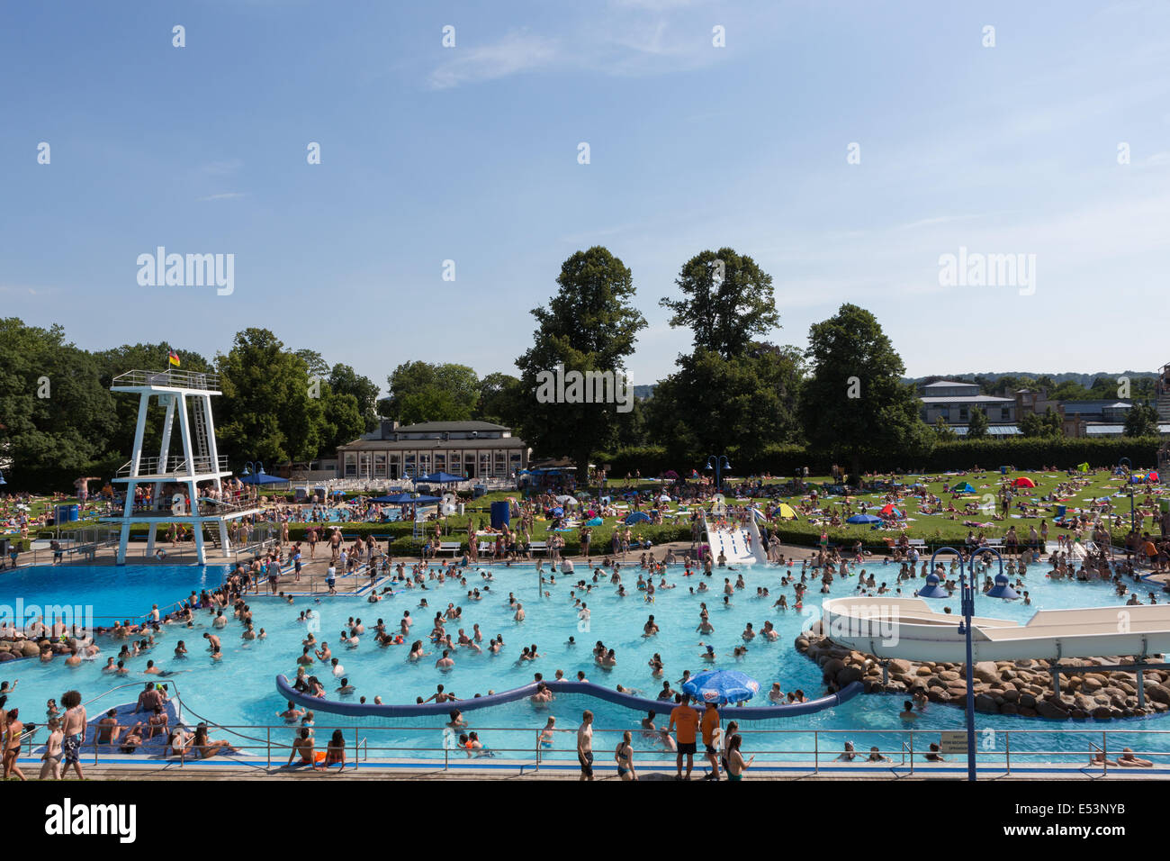 crowded outdoor swimming pool full of people bathing in germany on a stock photo 71997839 alamy. Black Bedroom Furniture Sets. Home Design Ideas