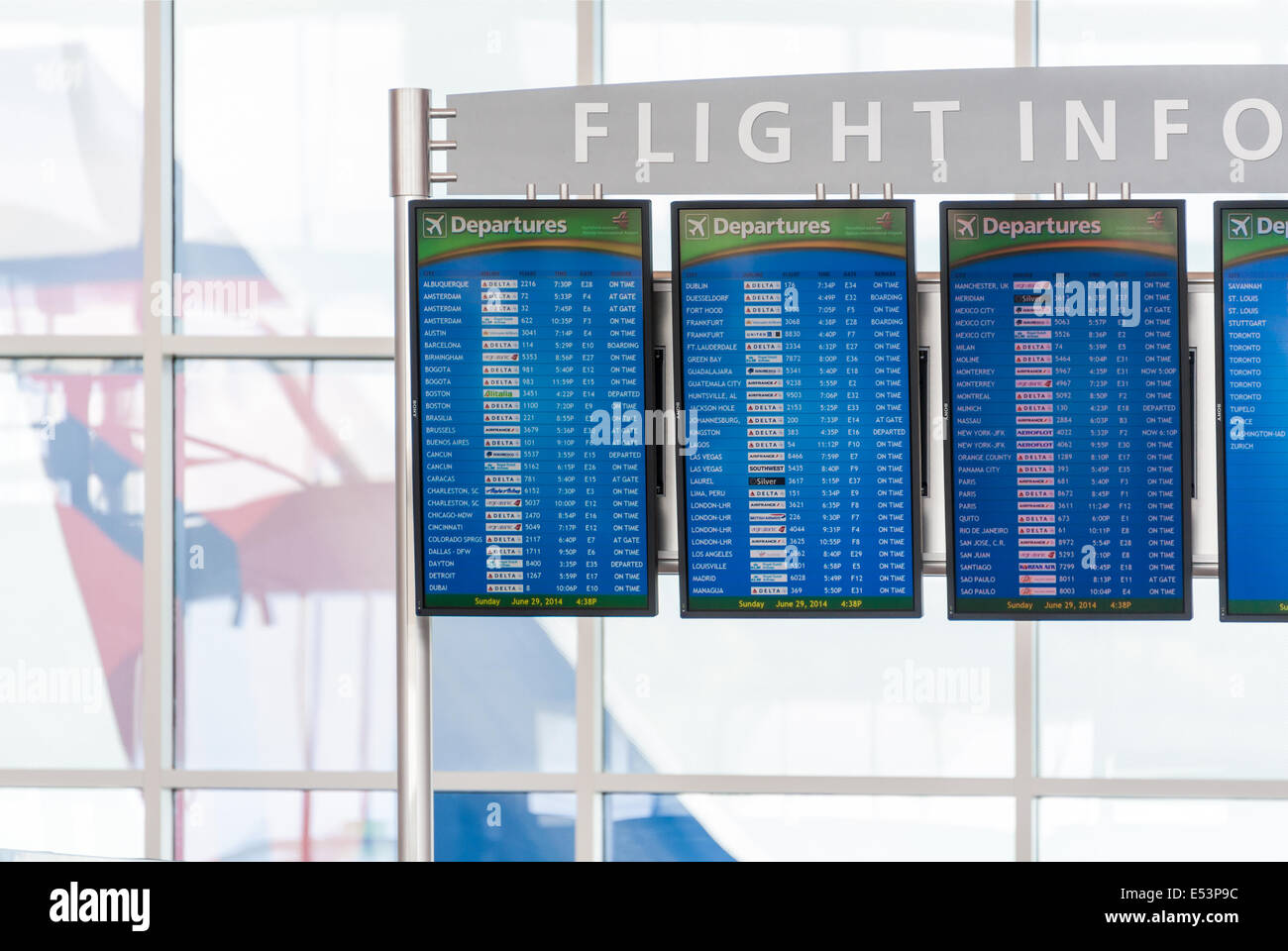 Flight info display with screens showing flight departures at the International Terminal of Atlanta International - Stock Image