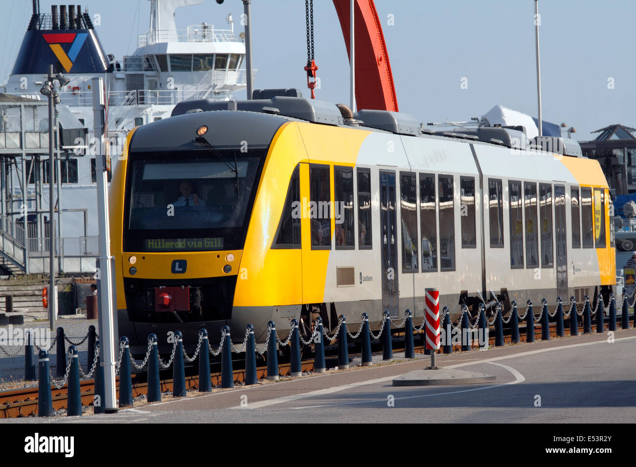 Local train and Scandlines ferry to Sweden on the busy harbour area in the port of Elsinore, Helsingør, Sealand, - Stock Image
