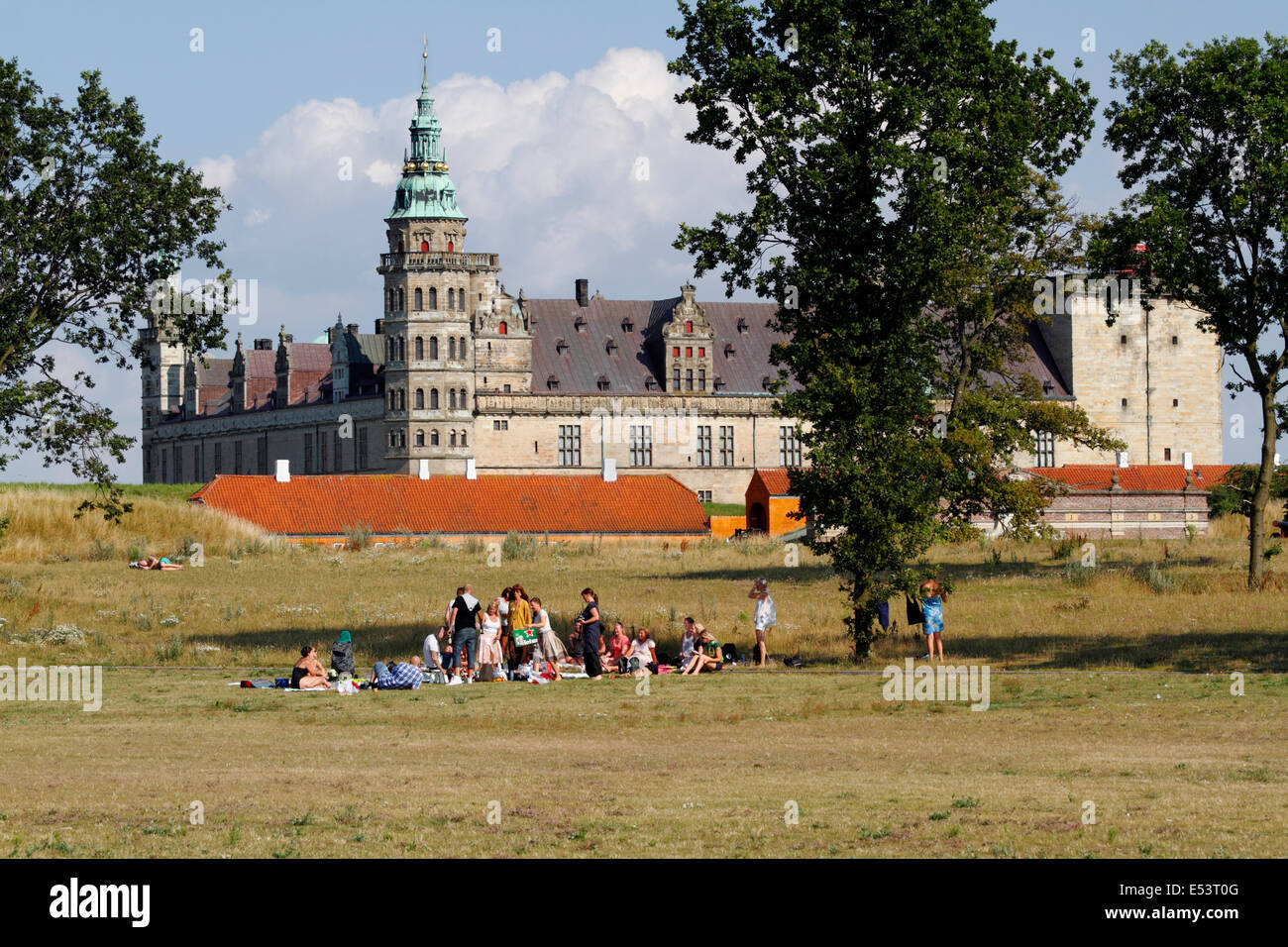 The green lawns around the Kronborg Castle in Elsinore, Helsingør, on a warm and sunny summer afternoon. Popular - Stock Image