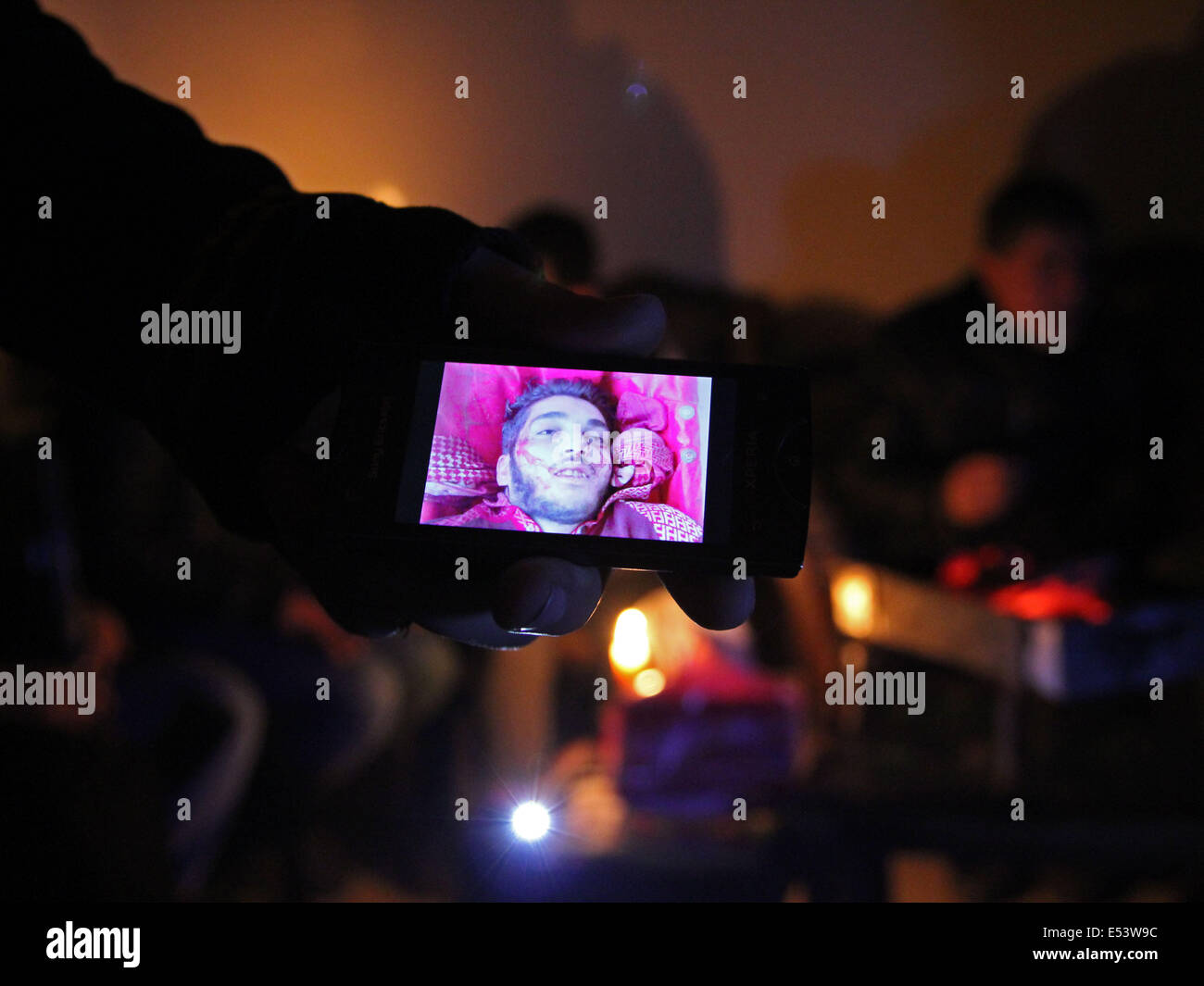 Aleppo, Syria. 16th Jan, 2013. A fighter shows an image of his best friend who was killed on the frontlines of Aleppo, - Stock Image