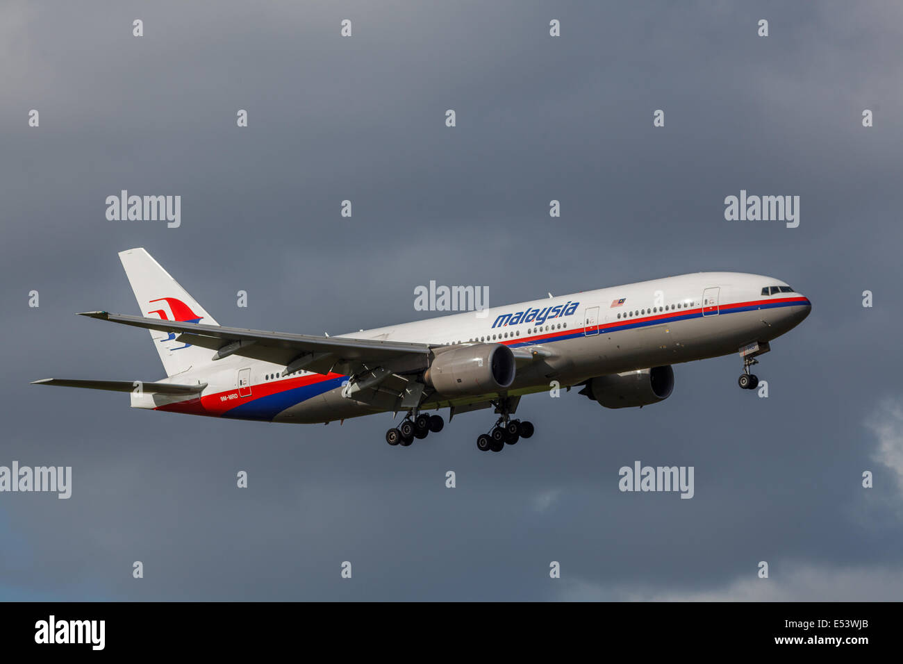 Malaysia Airlines, 9M-MRD, Boeing B777-200 landing at Auckland Airport,NZ before flying the MH17 route a couple - Stock Image