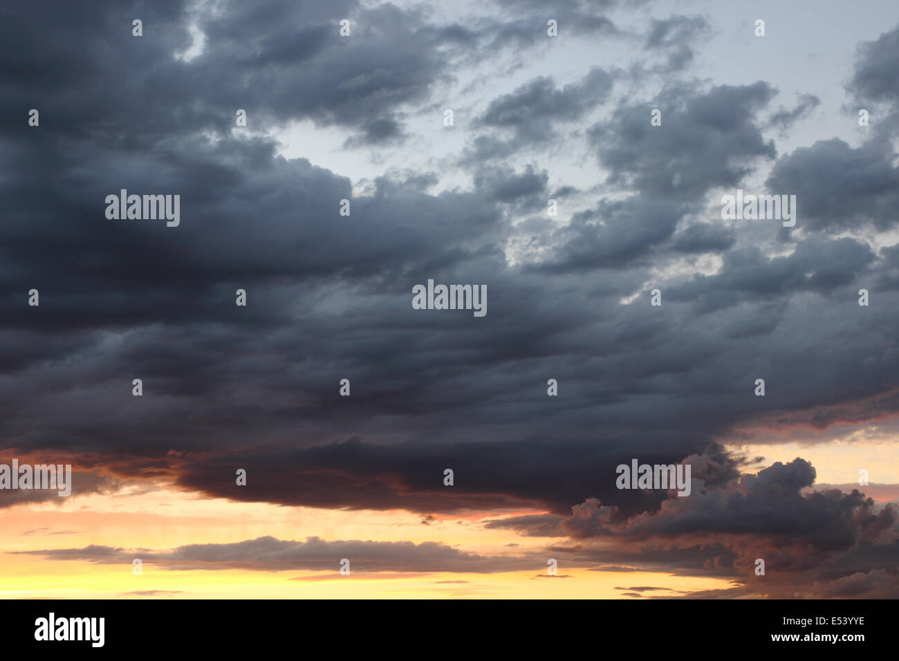 Sunset with dark clouds before the storm - Stock Image