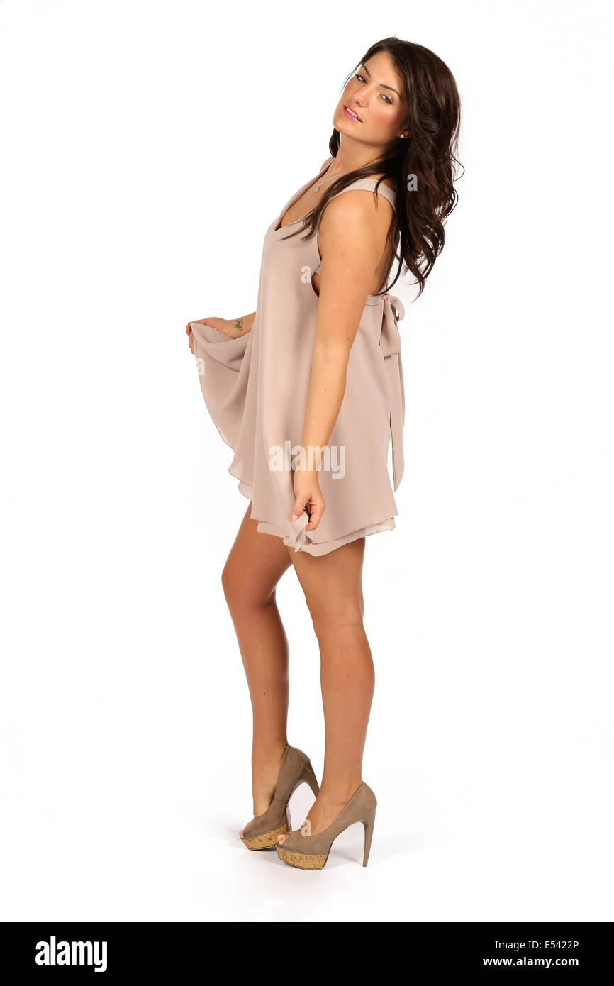 Studio shoot using female model with dark hair against a white background. Stock Photo