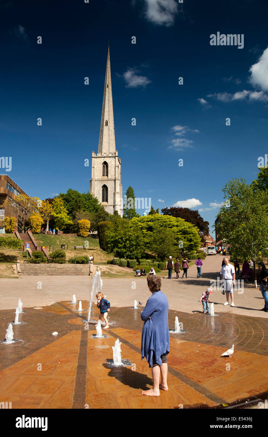 UK, England, Worcestershire, Worcester, South Quay, child playing in fountain on hot day - Stock Image