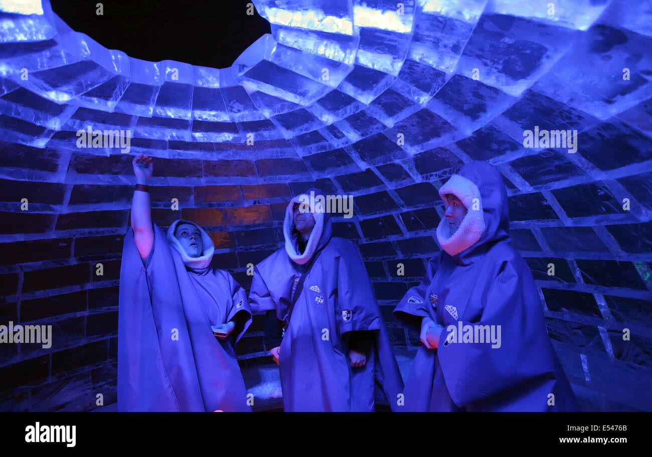 Roevershagen, Germany. 20th July, 2014. Visitors wear warm ponchos during a visit to the ice sculpture exhibition - Stock Image
