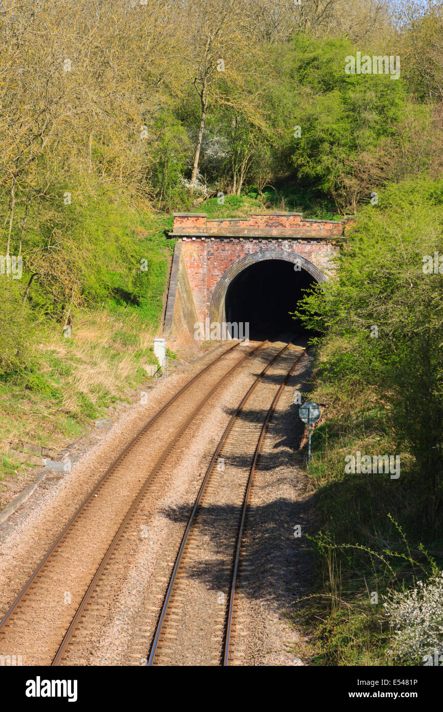Railway Line Entering Exiting A Tunnel Between Corby And
