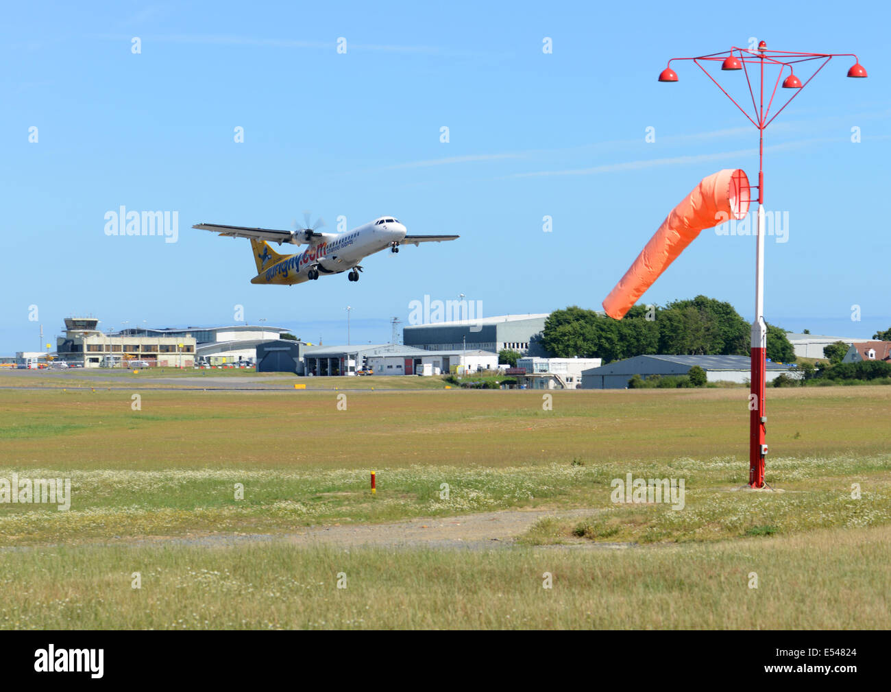 Aurigny new jet taking off from Guernsey Airport - Stock Image