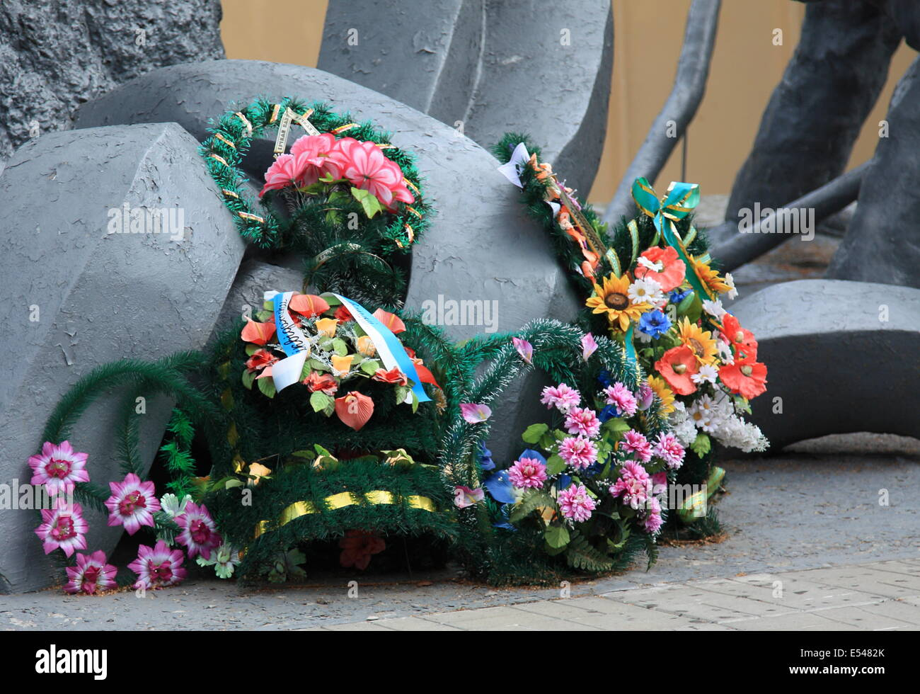 Flowers placed at the memorial to the firefighters who were killed after responding to the Chernobyl disaster. - Stock Image