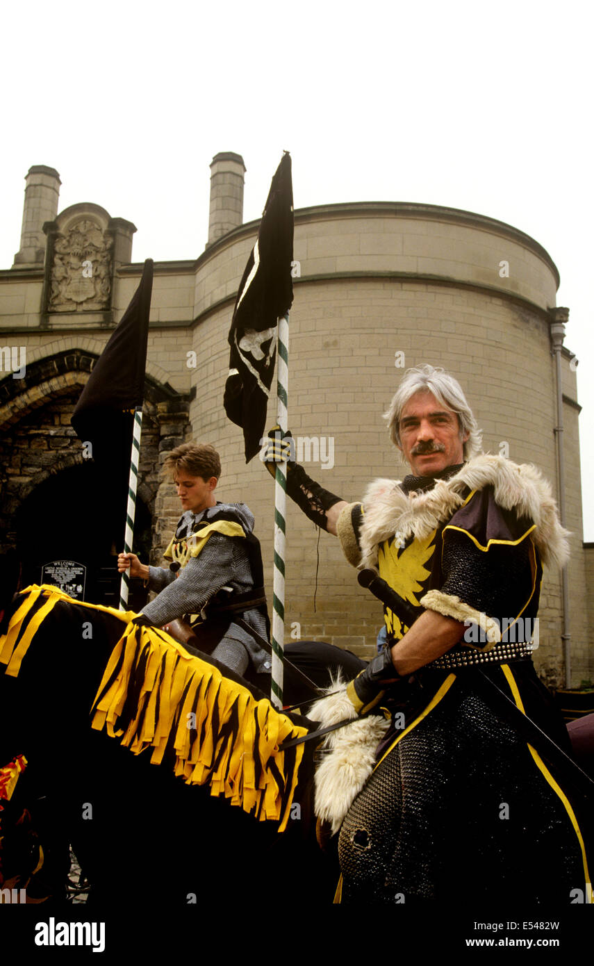 UK, England, Nottingham, Sheriff of Nottingham's men played by actor, on horseback outside the Castle gatehouse - Stock Image