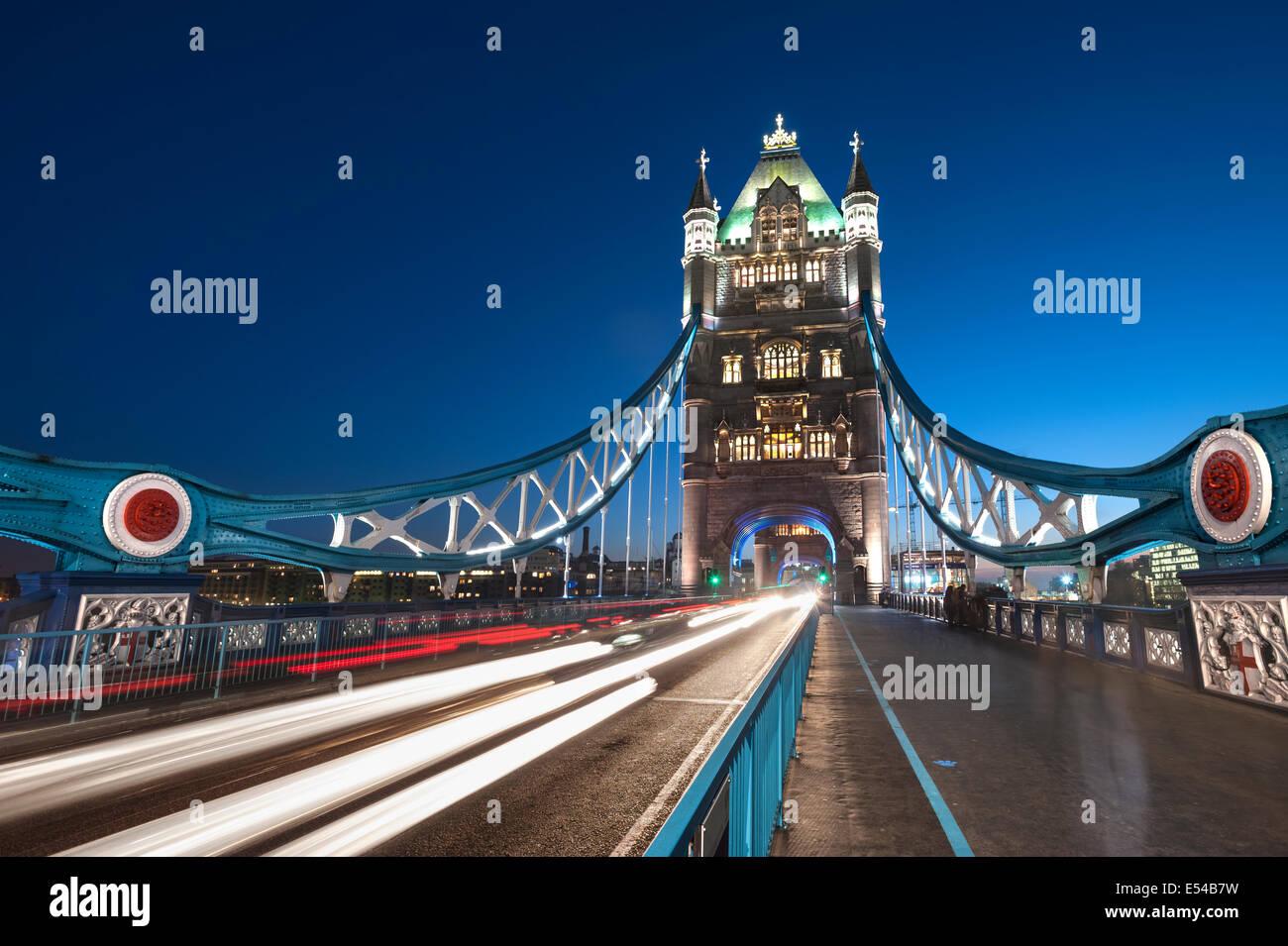 Tower Bridge at night with light trails London UK - Stock Image