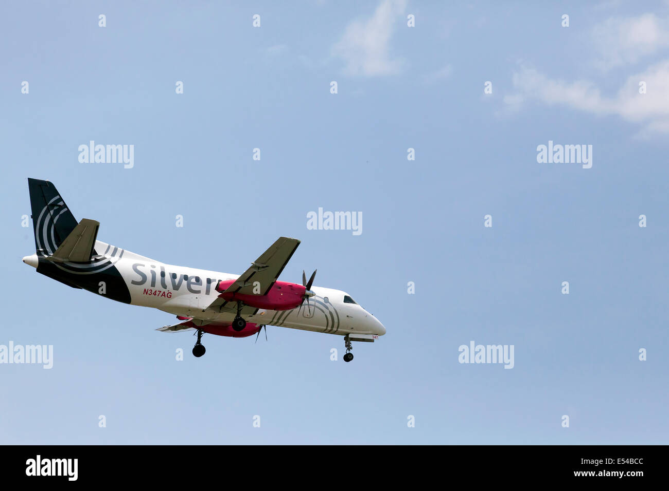 Saab 340B, a private twin prop propeller plane with the Silverado logo landing. - Stock Image