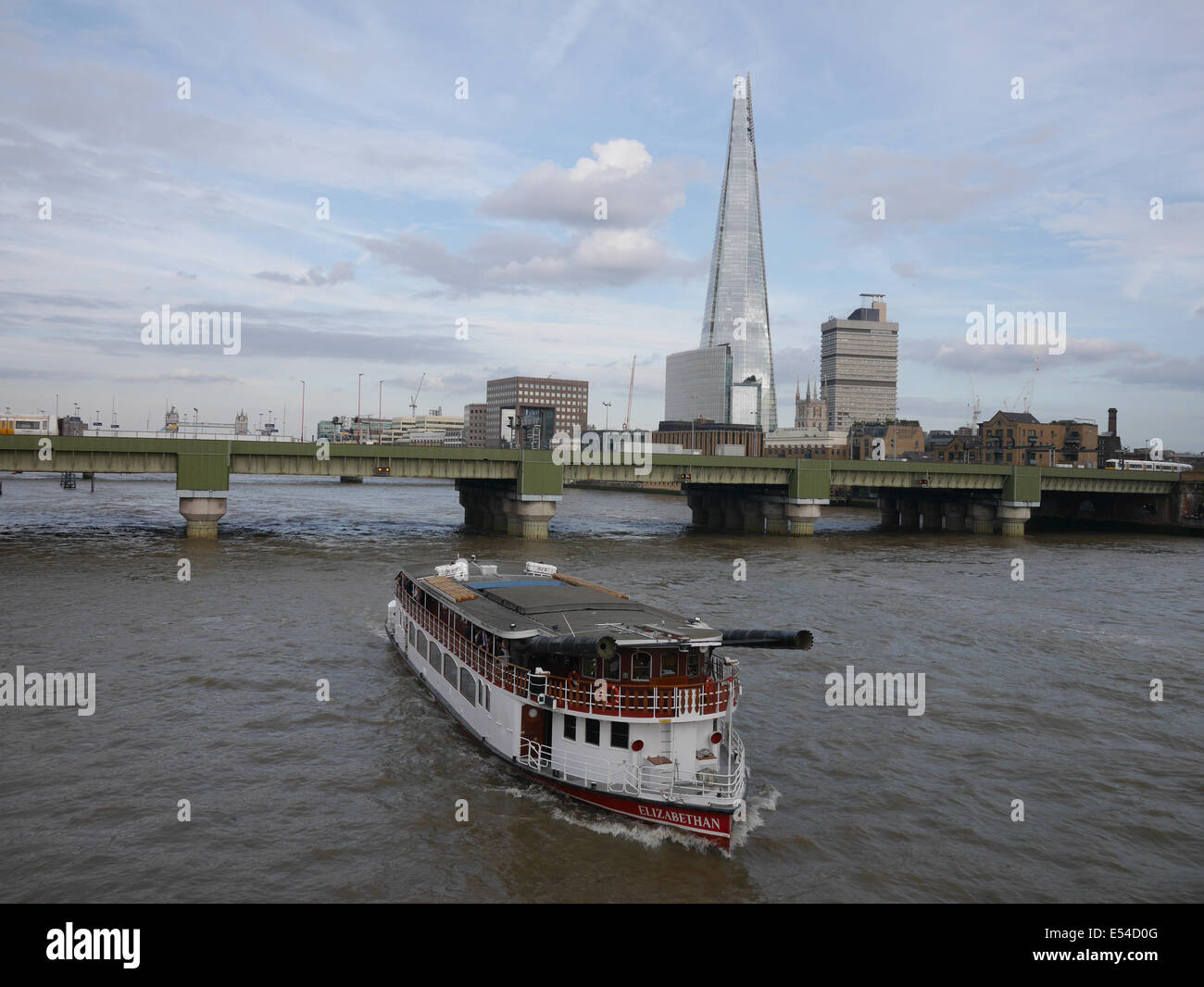 P.S. Elizabethan  replica boat modelled on Mississippi stern wheeled paddle steamer on River Thames with Shard in - Stock Image