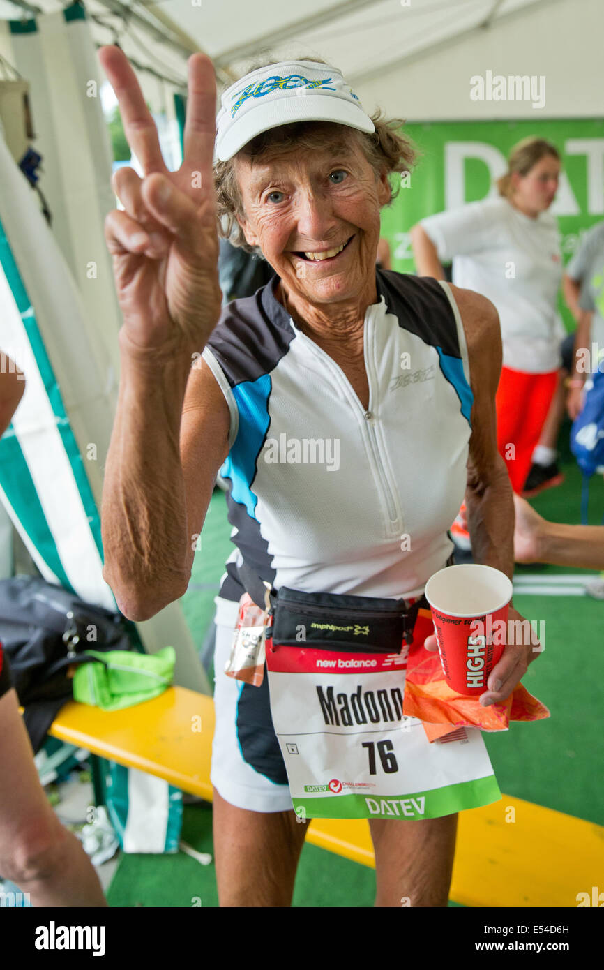 0f3bf8fb097 US triathlete Madonna Buder flashes the victory sign during the Datev  Challenge Roth in Hilpoltstein, Germany, 20 July 2014.