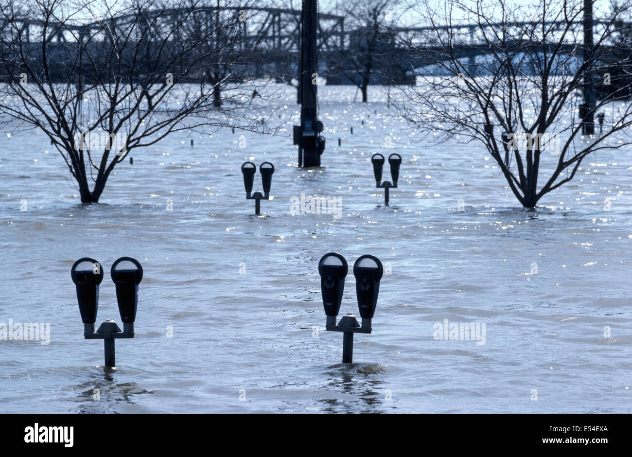 After heavy rains in 1979, the Illinois River floods nearby streets and threatens to immerse parking meters in downtown - Stock Image