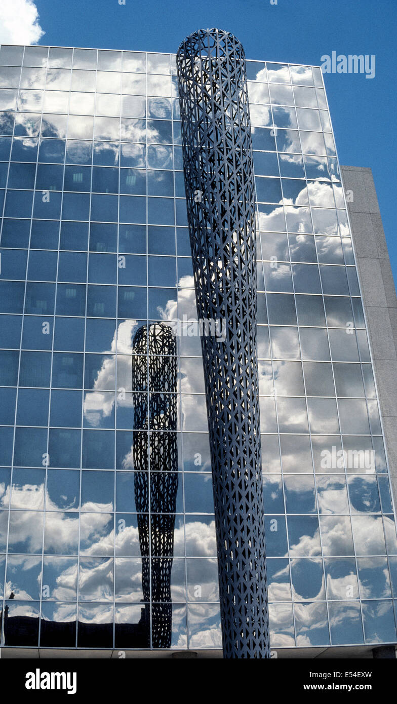 Batcolumn is a soaring outdoor sculpture that represents a baseball bat and reflects in mirrored office windows - Stock Image