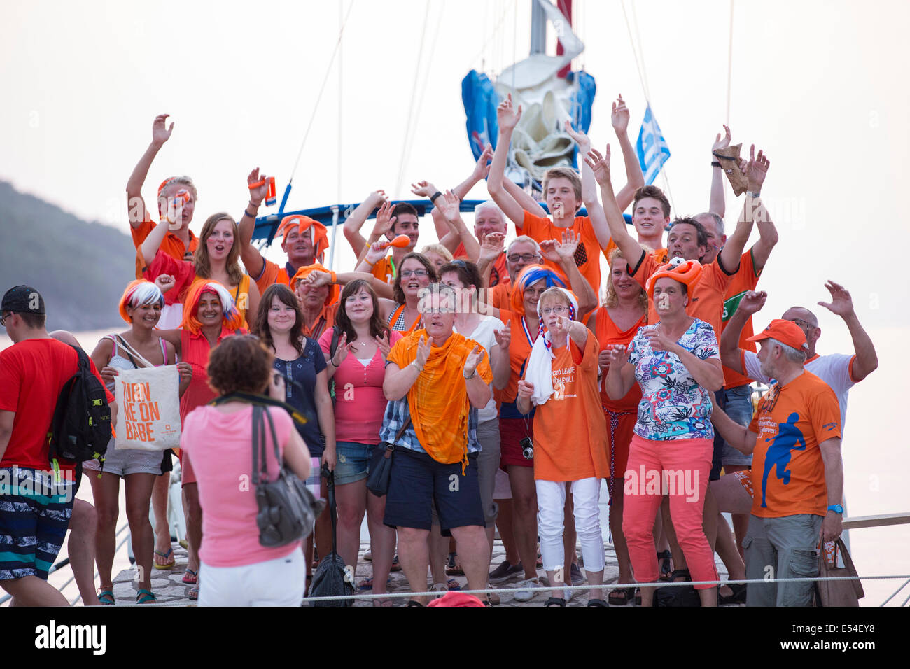 Dutch football fans celebrating a Dutch win in the world cup. - Stock Image