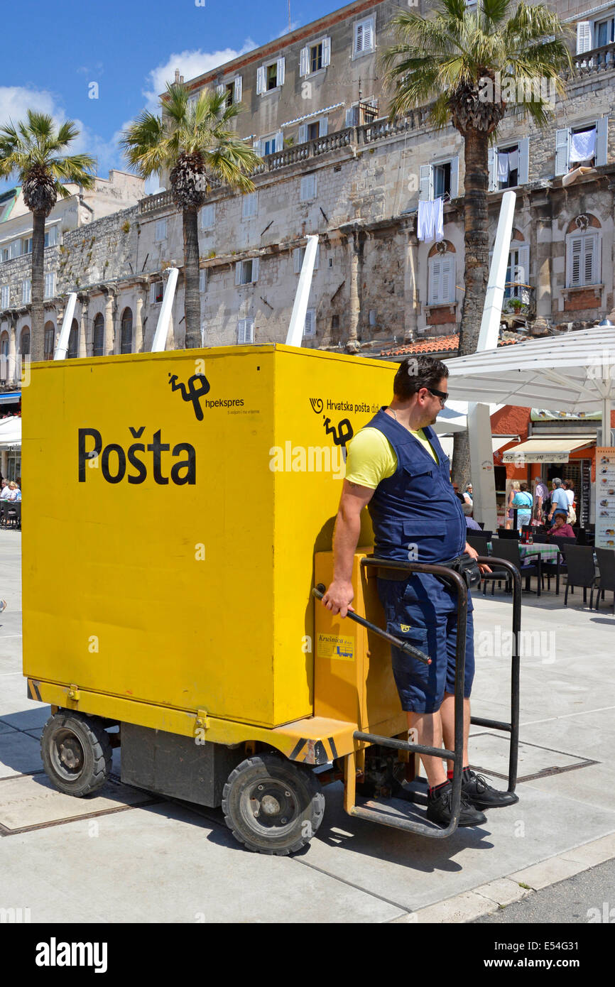 Postman driving an unusual Posta delivery vehicle in Split town centre postal service - Stock Image