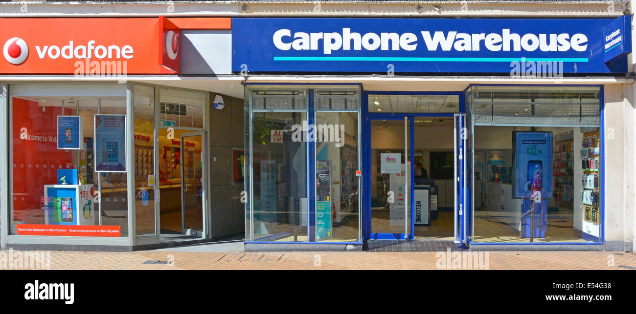 Vodafone and Carphone Warehouse shop premises in town centre shopping high street - Stock Image