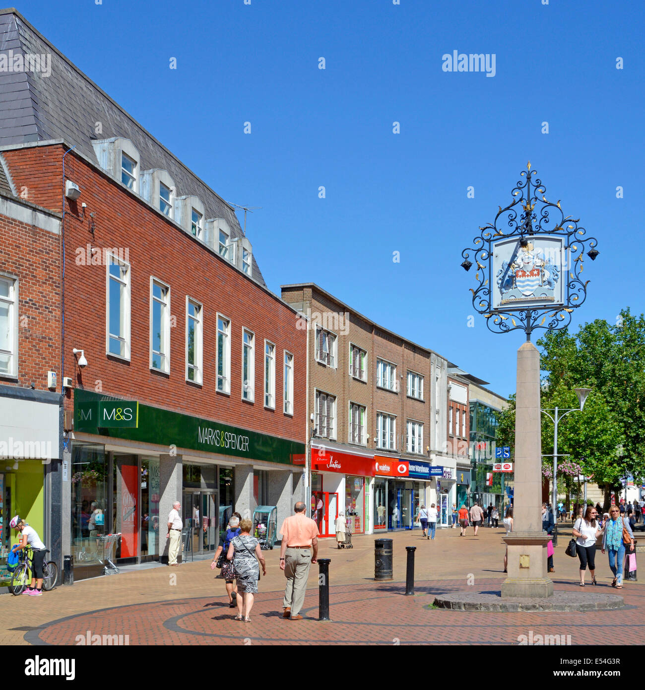 Chelmsford (county town of Essex) city centre pedestrianised shopping high street with coat of arms - Stock Image