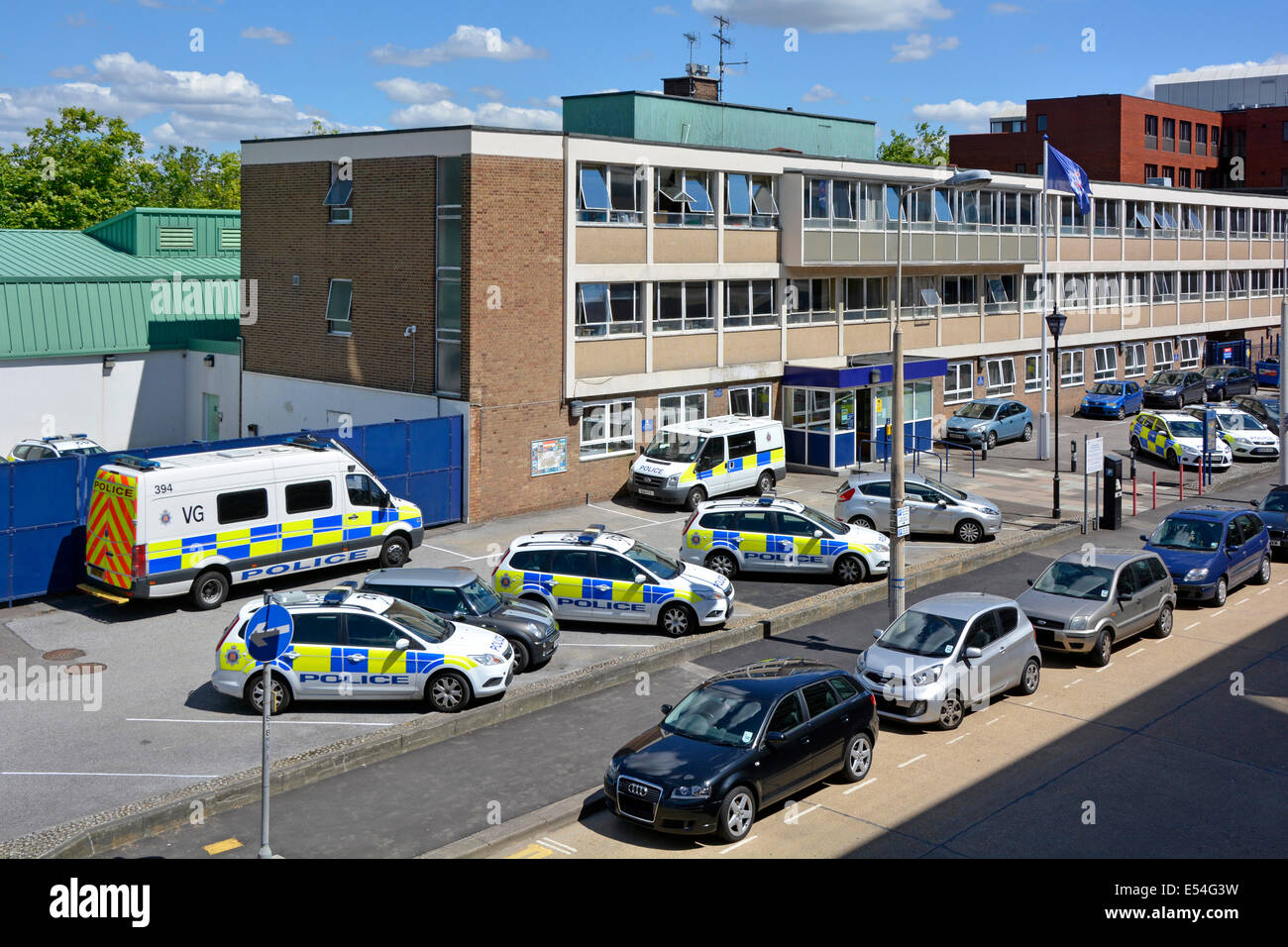Police cars and vans parked outside entrance to Basildon police station - Stock Image