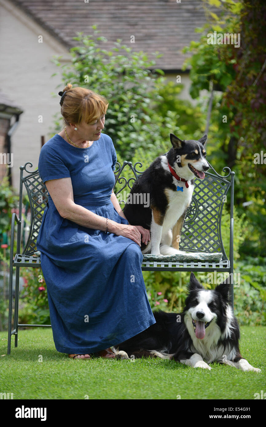 Woman with family pet pets dog dogs - Stock Image
