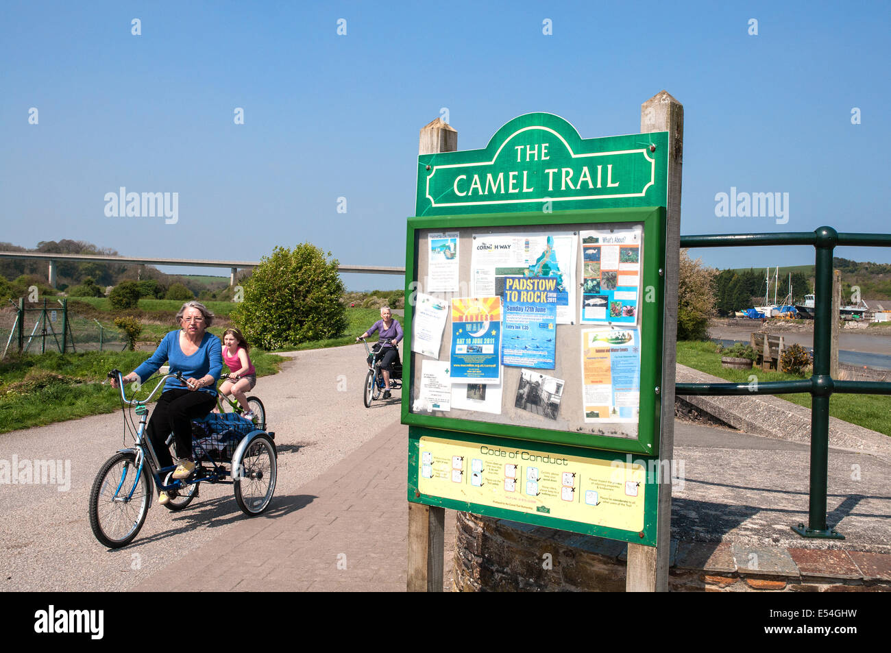 Cyclists on the Camel trail cycle path that runs between Wadebridge and Padstow in Cornwall, UK - Stock Image