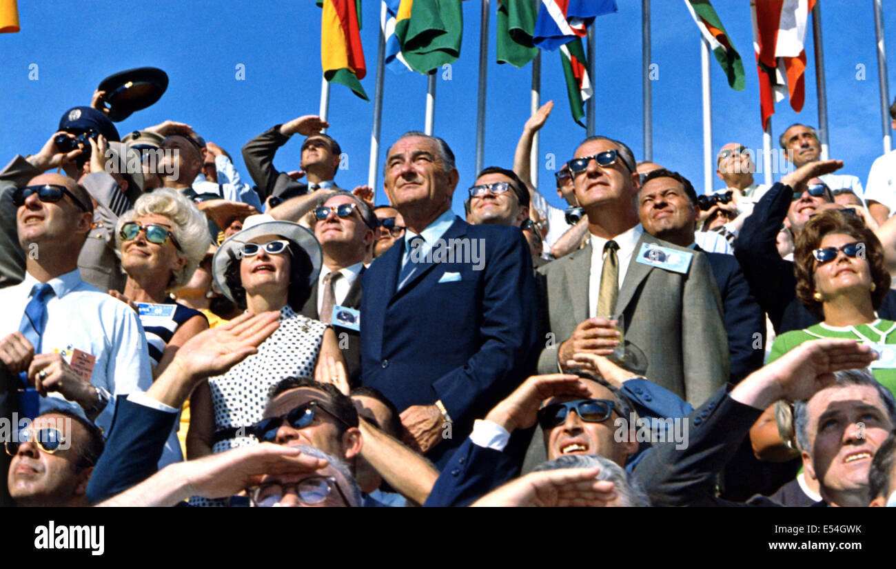 Former President Lyndon B. Johnson and Vice President Spiro Agnew watch as the Saturn V rocket launches with the - Stock Image