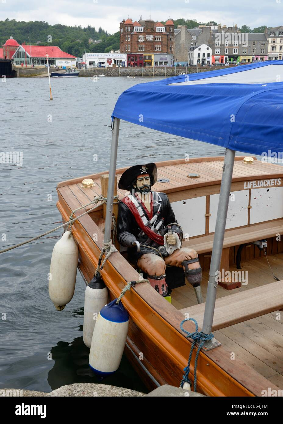 Passengers on trips on the boat 'Purple heather' are accompanied by this life size pirate figure. - Stock Image