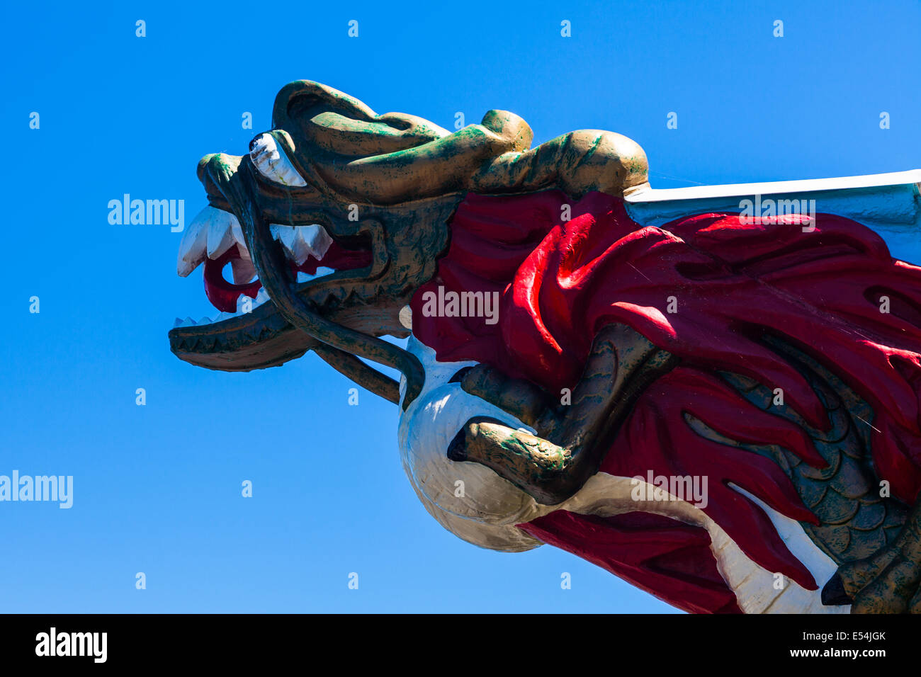 Flaming Dragon head against a blue sky, Stanley Park, Vancouver - Stock Image