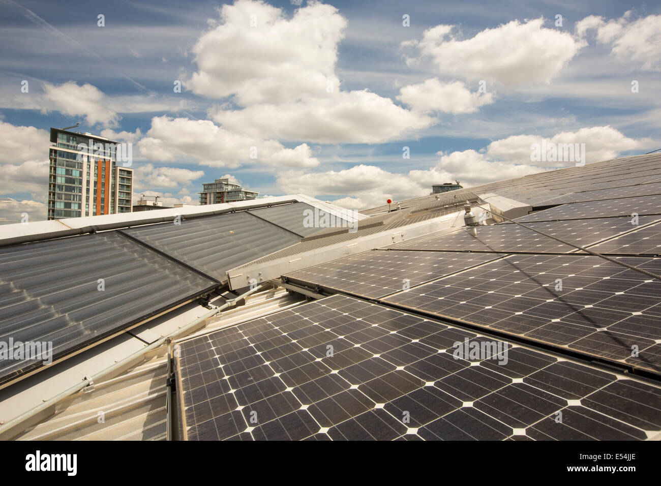 Solar Thermal And Solar Pv Panels On The Roof Of The