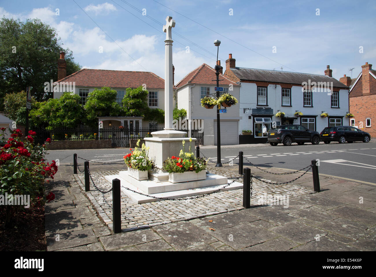 War memorial and housing in the Thameside village of Bray in Berkshire England UK - Stock Image