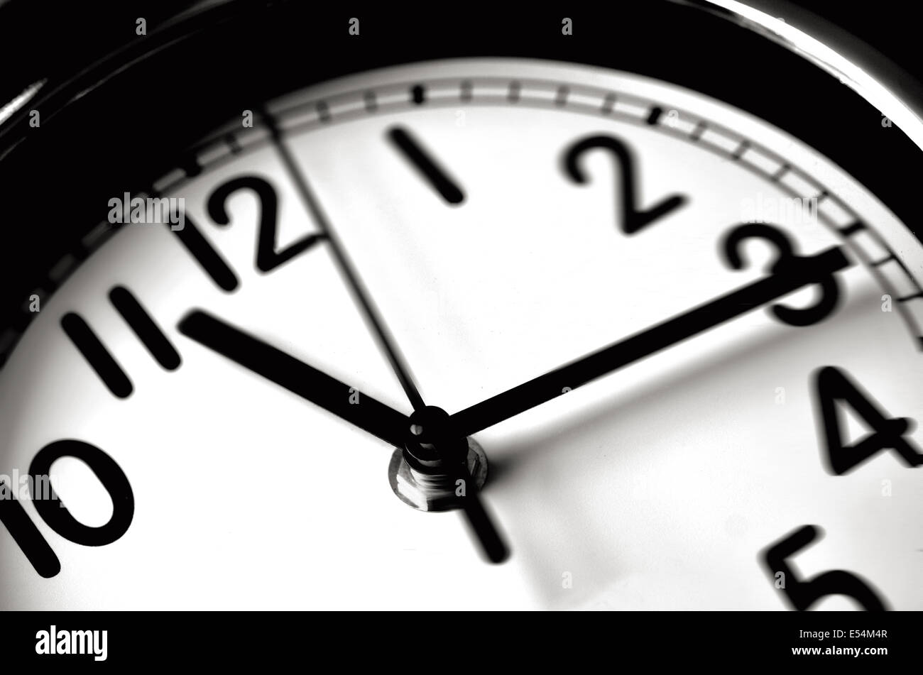 Time passing over the face of home office Wall Clock. Concept photo of time, timing ,business, busy,deadline. - Stock Image