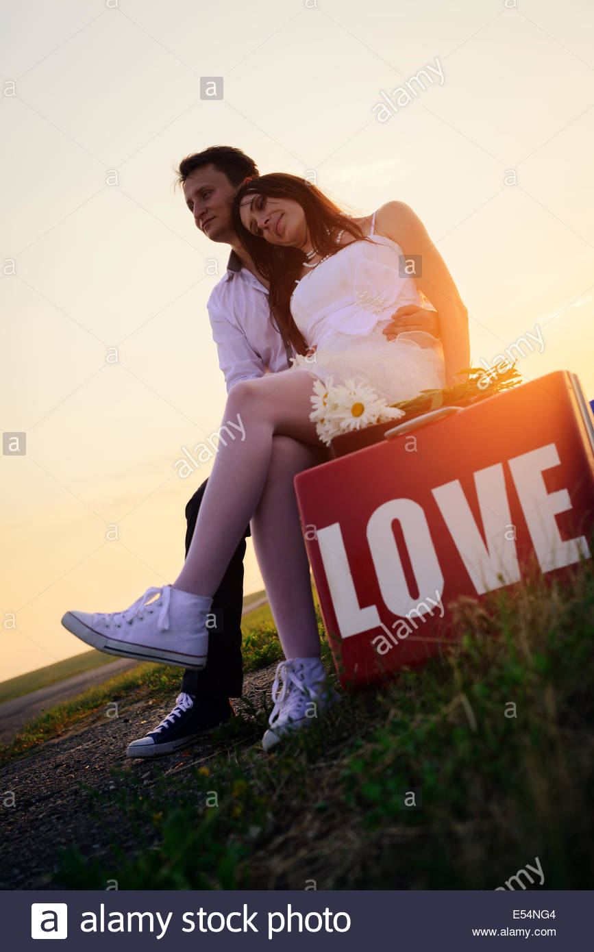 wedding of loving unusual couple at bus stop - Stock Image